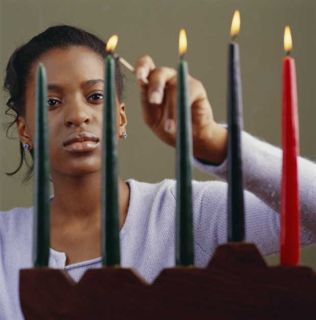 Young Woman Lighting Menorah Candles